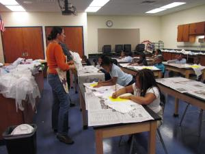Teaching Artist Wendy Mahon helping students brainstorm their visual art design.